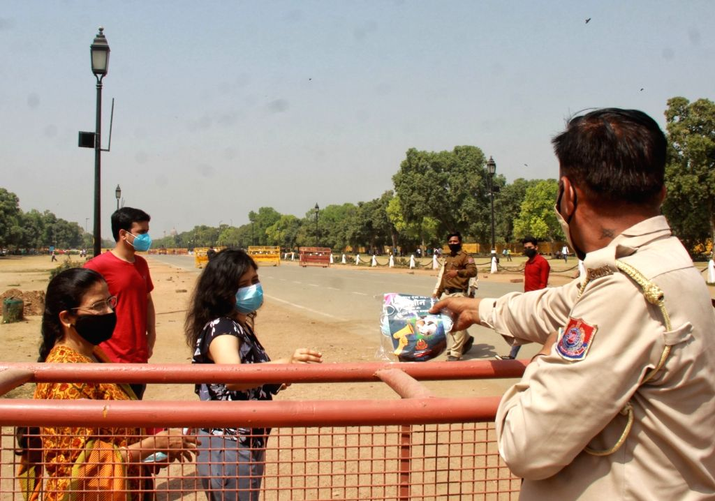 Delhi Civil Defence officials distribute Masks, Hand Sanitizer to people. Organized by New Delhi District Administration at India Gate in New Delhi on Saturday March 27th, 2021.
