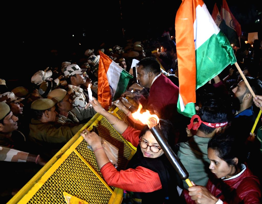 Delhi Commission for Women (DCW) members participate in a candlelight vigil to express solidarity with rape victims and to oppose rising incidents of crimes against women, in New Delhi on ...