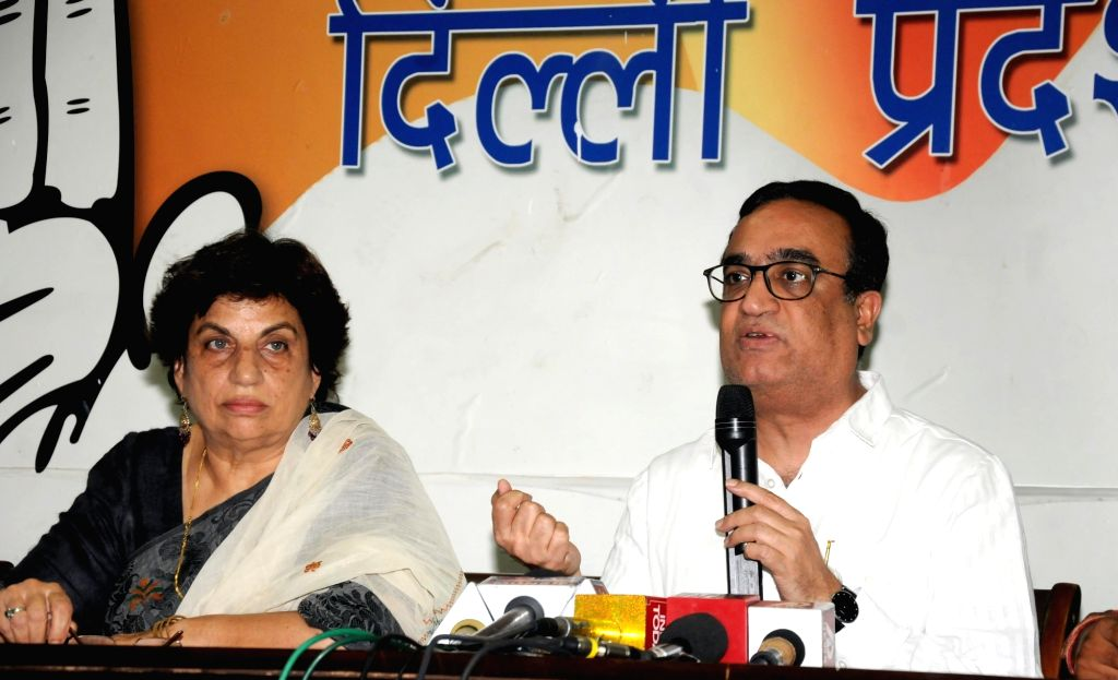 Delhi Congress chief Ajay Maken addresses a press conference in New Delhi, on May 25, 2016. Also seen Congress leader Kiran Walia.