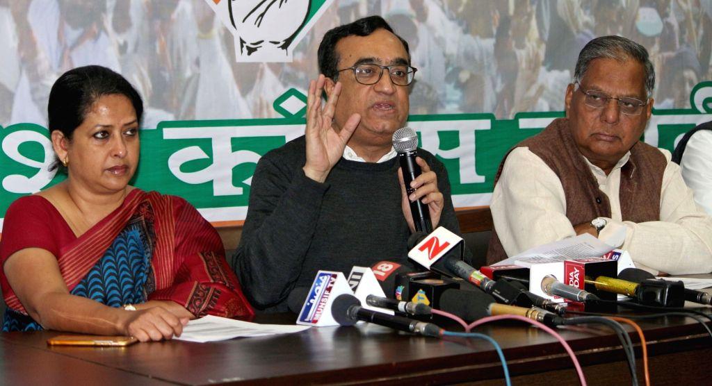Delhi Congress chief Ajay Maken addresses a press conference, in New Delhi on March 14, 2017. Also seen Congress leader Sharmistha Mukherjee. - Sharmistha Mukherjee