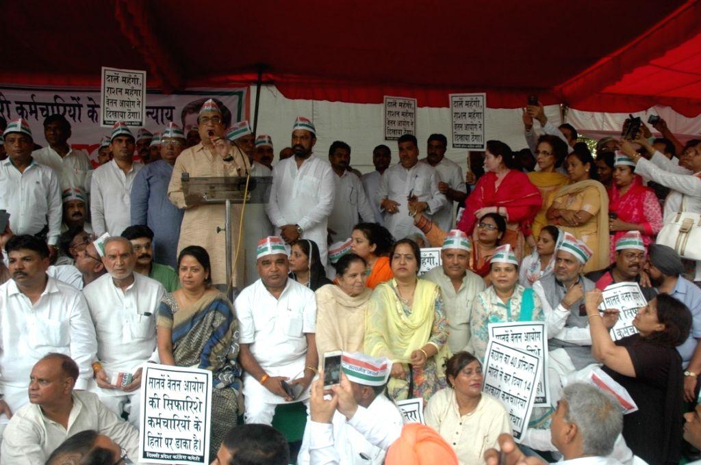 Delhi Congress chief Ajay Maken addresses during a demonstration at a Jantar Mantar in New Delhi on July 2, 2016.