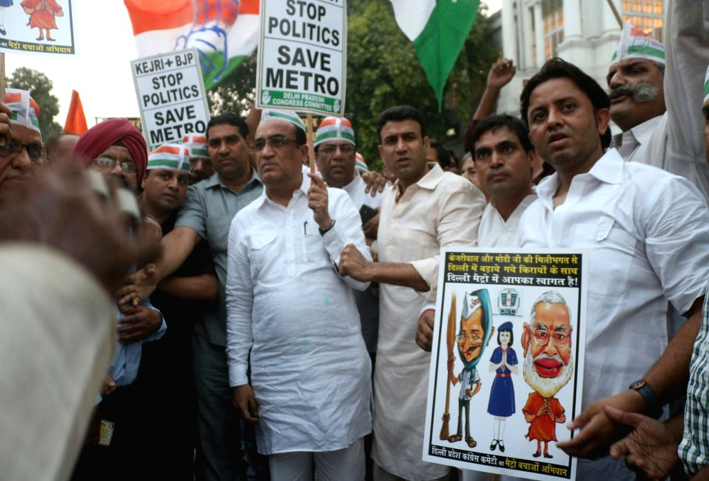 Delhi Congress chief Ajay Maken along with party workers stage a demonstration against hike in metro fares at Rajiv Chowk metro station in New Delhi on Oct 11, 2017.