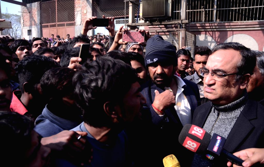 Delhi Congress chief Ajay Maken arrives at the plastic factory warehouse, which was also used to store firecrackers where a major fire broke out on Saturday evening. As many as 17 persons, ...