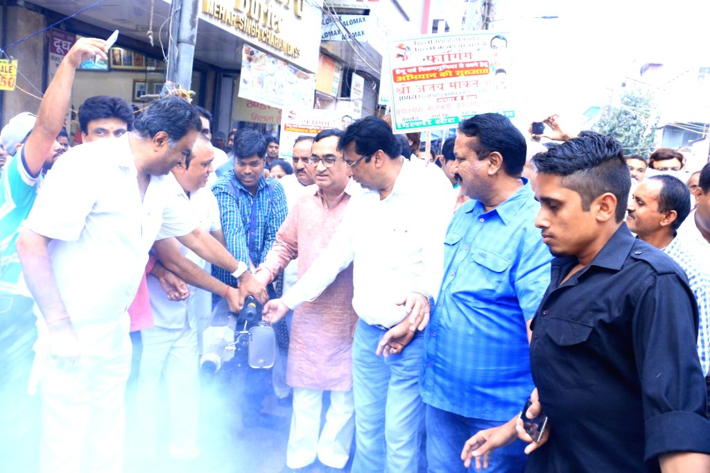 Delhi Congress chief Ajay Maken launches fogging drive initiated by Delhi State Traders Congress in New Delhi, on Sept 18, 2016.