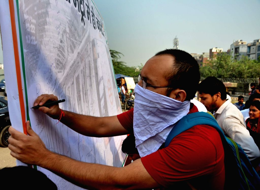 Delhi Congress chief Ajay Maken leads a signature campaign against hike in metro fares in New Delhi, on Oct 13, 2017.