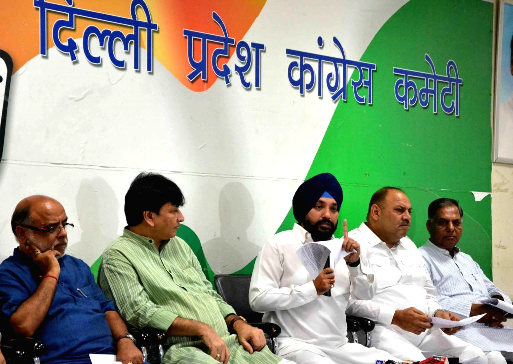 Delhi Congress chief Arvinder Singh Lovely release a 'Charge against AAP and BJP Rule` in New Delhi on Aug 21, 2014. - Arvinder Singh Lovely