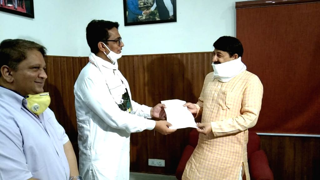 Delhi Congress President Anil Kumar meets BJP MP Manoj Tiwari and submits a memorandum demanding a reduction in the inflated prices of petrol and diesel, in New Delhi on July 5, 2020. - Kumar