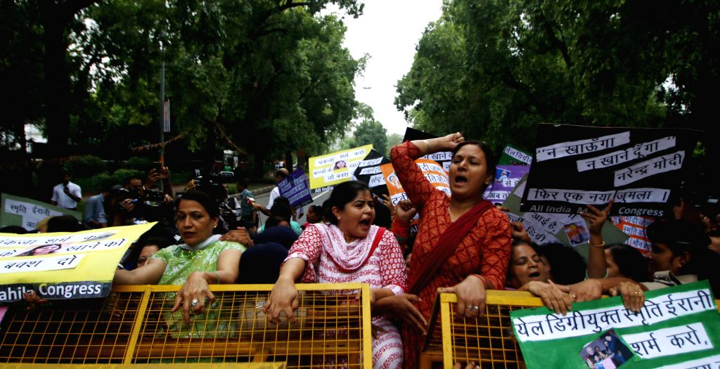 Delhi Congress women workers stage a demonstration against NDA government outside the BJP headquarters in New Delhi on June 25, 2015.