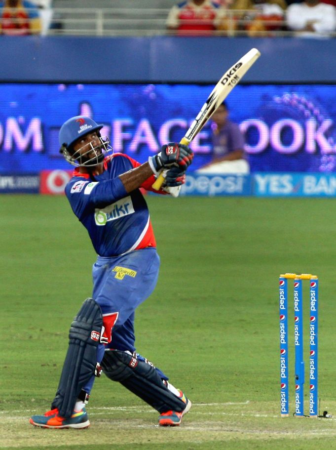 Delhi Daredevils batsman Dinesh Karthik gestures after scoring a half century during the match against Kolkata Knight Riders at Dubai International Cricket Stadium on April 19, 2014. - Dinesh Karthik