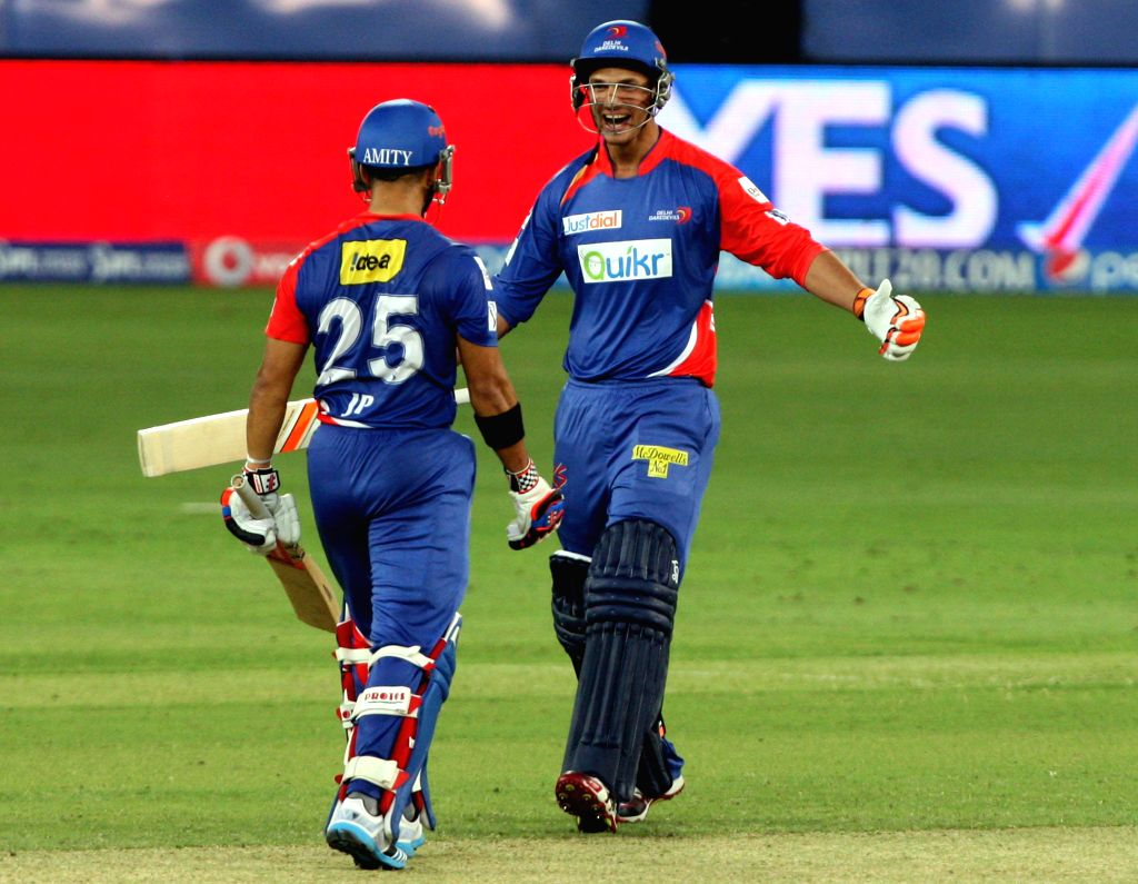 Delhi Daredevils batsmen JP Duminy and Nathan Coulter-Nile celebrates after wining the match against Kolkata Knight Riders at Dubai International Cricket Stadium on April 19, 2014.