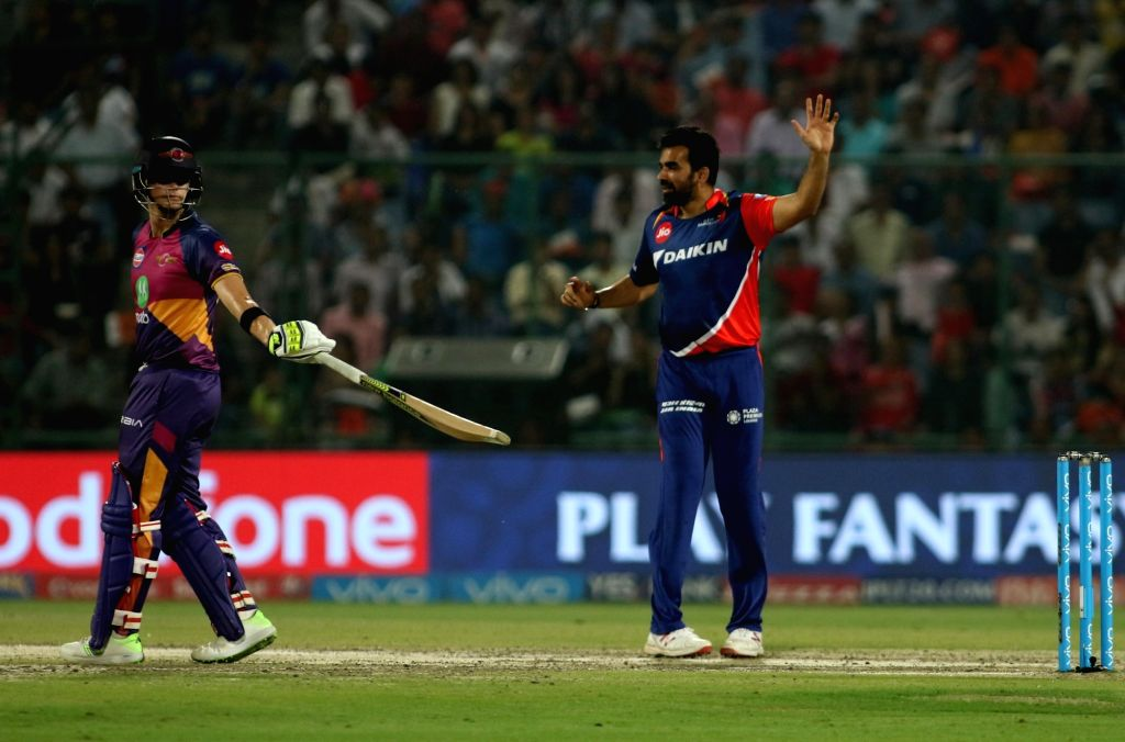 Delhi Daredevils captain Zaheer Khan celebrates wicket of Rahul Tripathi of Rising Pune Supergiant on the first ball of the innings during match between the Delhi Daredevils and the ... - Zaheer Khan and Rahul Tripathi