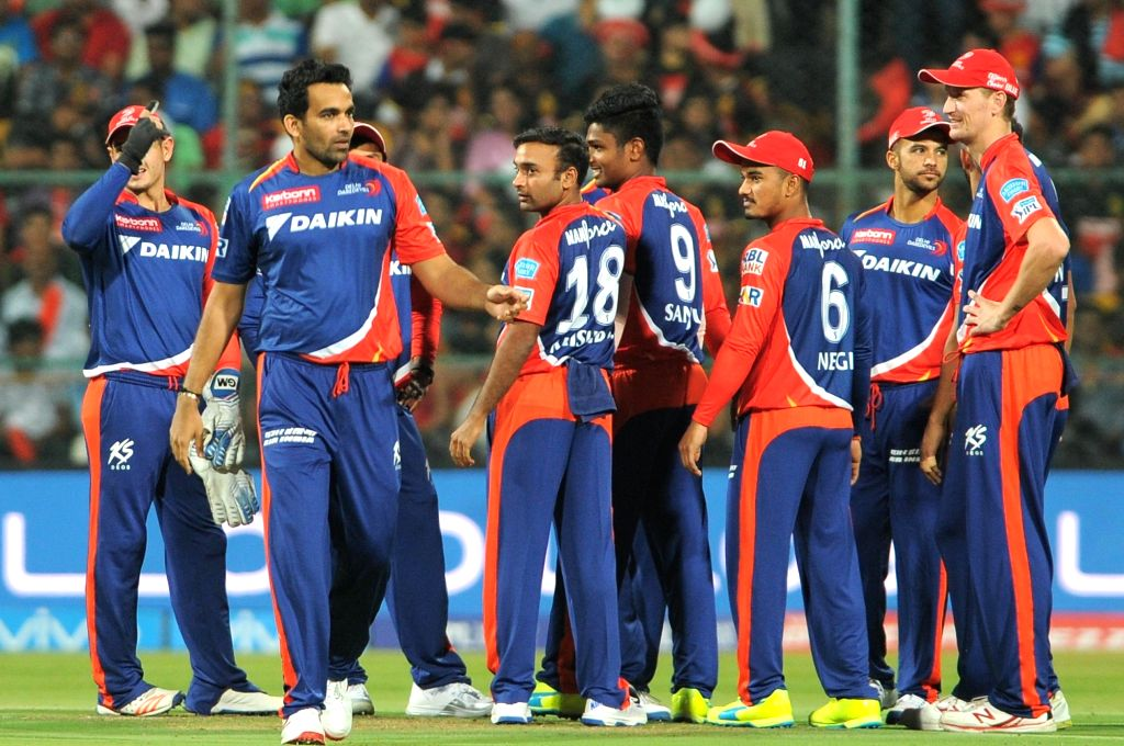 Delhi Daredevils celebrate fall of a wicket during an IPL match between Royal Challengers Bangalore and Delhi Daredevils at M Chinnaswamy Stadium in Bengaluru, on April 17, 2016.