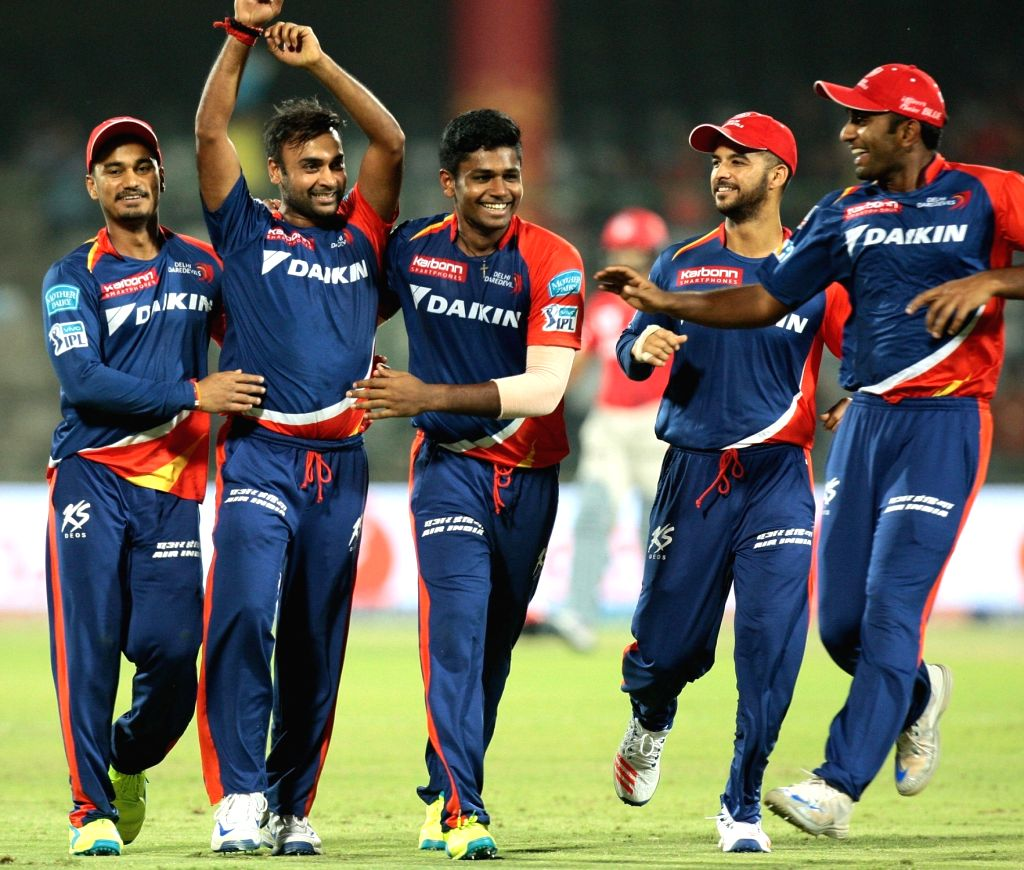Delhi Daredevils players celebrate fall of a wicket during an IPL match between Delhi Daredevils and Kings XI Punjab at Feroz Shah Kotla Stadium in New Delhi on April 15, 2016.
