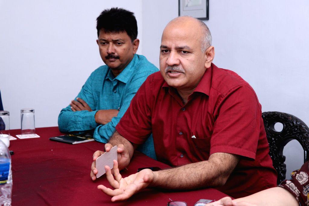 Delhi Deputy Chief Minister and AAP leader Manish Sisodia talks to media, in Panaji, on July 23, 2018.