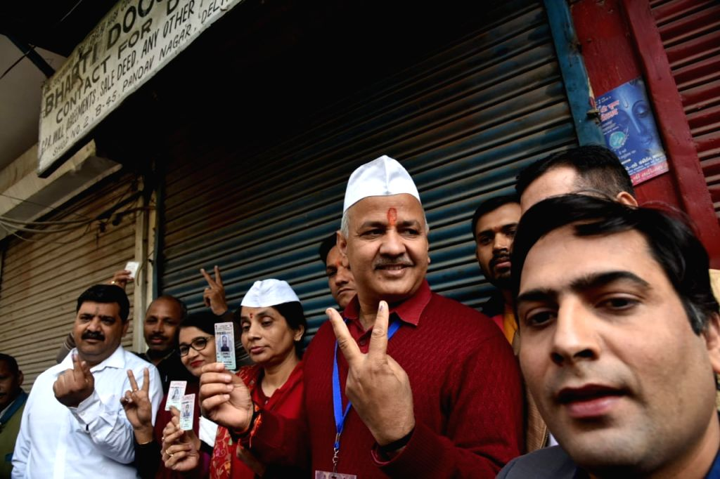 Delhi Deputy Chief Minister and AAP's candidate from Patparganj Manish Sisodia displays victory sign after casting his vote for the Delhi Assembly elections 2020, on Feb 8, 2020.