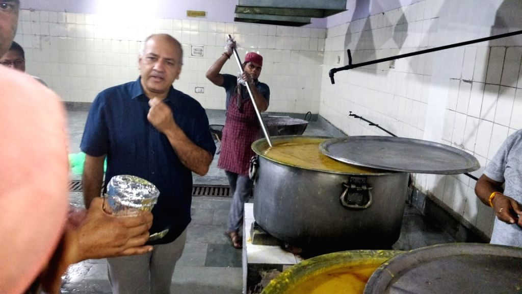 Delhi Deputy Chief Minister and Education Minister Manish Sisodia inspects the preparation of mid-day meal at a mid-day meal base kitchen in Delhi's Dilshad Garden on July 9, 2018. ... - Manish Sisodia