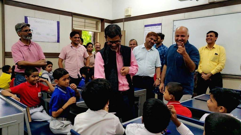 Delhi Deputy Chief Minister and Education Minister Manish Sisodia and Meghalaya Education Minister Lahkmen Rymbui interact with children during their visit to Sarvodaya Vidyalaya, Rouse ... - Manish Sisodia