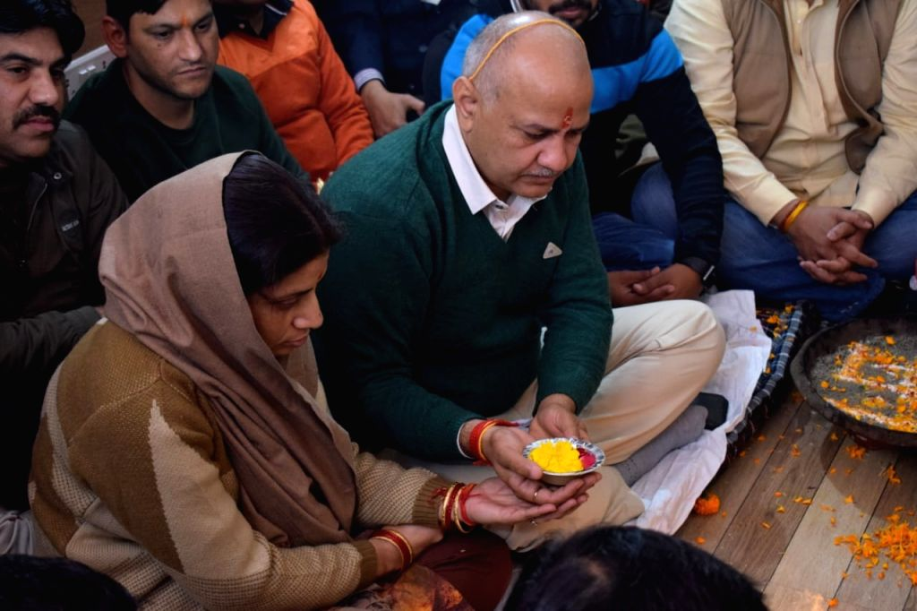 Delhi Deputy Chief Minister and senior AAP leader Manish Sisodia performs rituals during the inauguration of his Legislative Assembly Office in New Delhi on Jan 12, 2020.