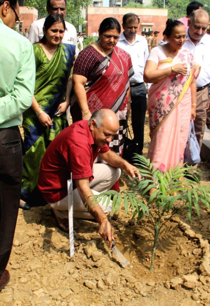 Delhi Deputy Chief Minister Manish Sisodia ploughts the soil to plant a sapling during the inauguration of Rajkiya Pratibha Vikash Vidhyalaya at Dwarka Sec- 5, in New Delhi on July 10, ... - Manish Sisodia