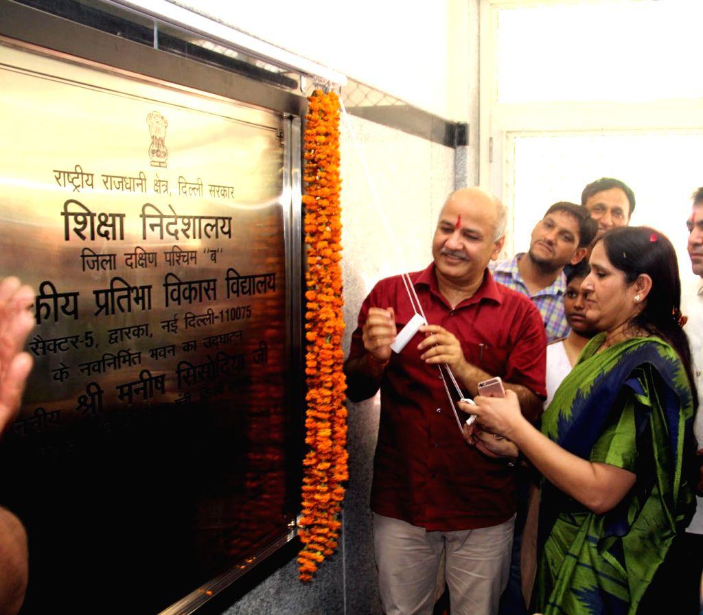 Delhi Deputy Chief Minister Manish Sisodia unveils the plaque to inaugurate Rajkiya Pratibha Vikash Vidhyalaya at Dwarka Sec- 5, in New Delhi on July 10, 2018. - Manish Sisodia