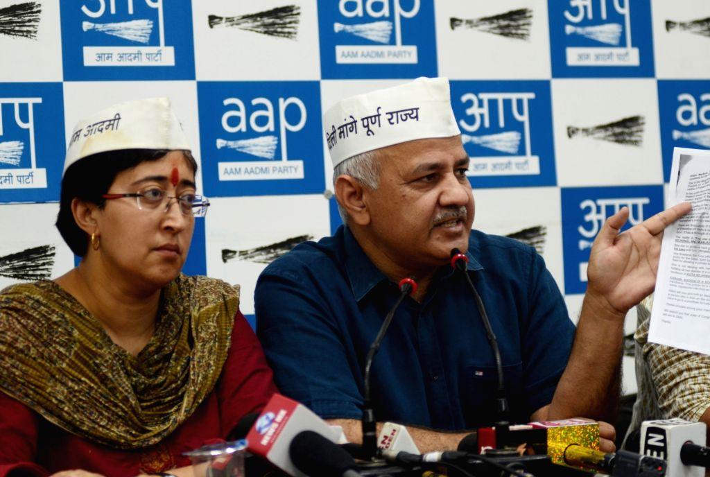 Delhi Deputy Chief Minister Manish Sisodia accompanied by AAP's Lok Sabha candidate from East Delhi Atishi Marlena, addresses a press conference, in New Delhi on May 9, 2019. - Manish Sisodia