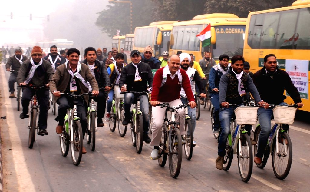 Delhi Deputy Chief Minister Manish Sisodia and others ride cycles on car free day in New Delhi, on Jan 22, 2016. - Manish Sisodia