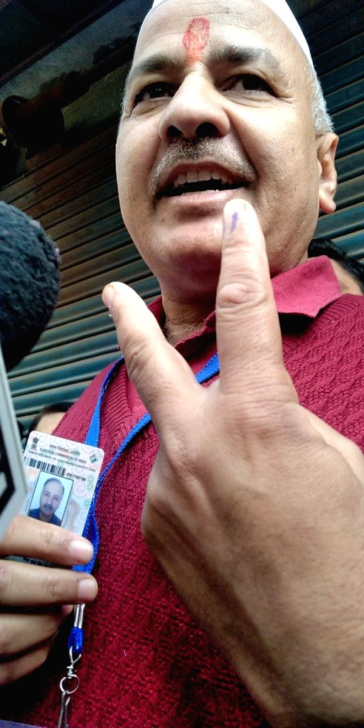 Delhi Deputy Chief Minister Manish Sisodia shows his finger marked with inedible ink after casting his vote for the Delhi Assembly elections 2020, at a polling booth in New Delhi on Feb 8, ... - Manish Sisodia