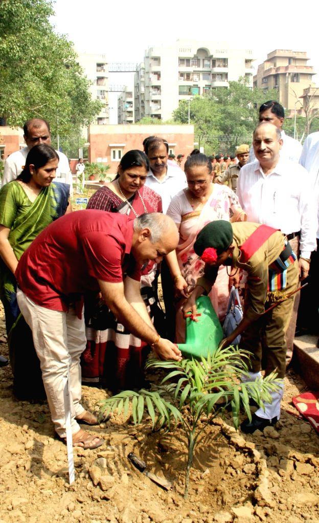 Delhi Deputy Chief Minister Manish Sisodia waters a plant during the inauguration of Rajkiya Pratibha Vikash Vidhyalaya at Dwarka Sec- 5, in New Delhi on July 10, 2018. - Manish Sisodia
