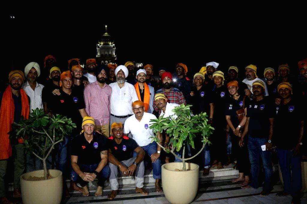 Delhi Dynamos FC players visit Bangal Shahib Gurdwara in New Delhi on Sept 30, 2016.