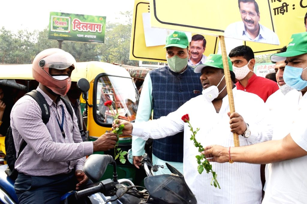 Delhi Employment, Development, Labour, General Administration and Irrigation Minister Gopal Rai and Food and Civil Supplies, Environment & Forests Minister Imran Hussain offer roses to ... - Gopal Rai