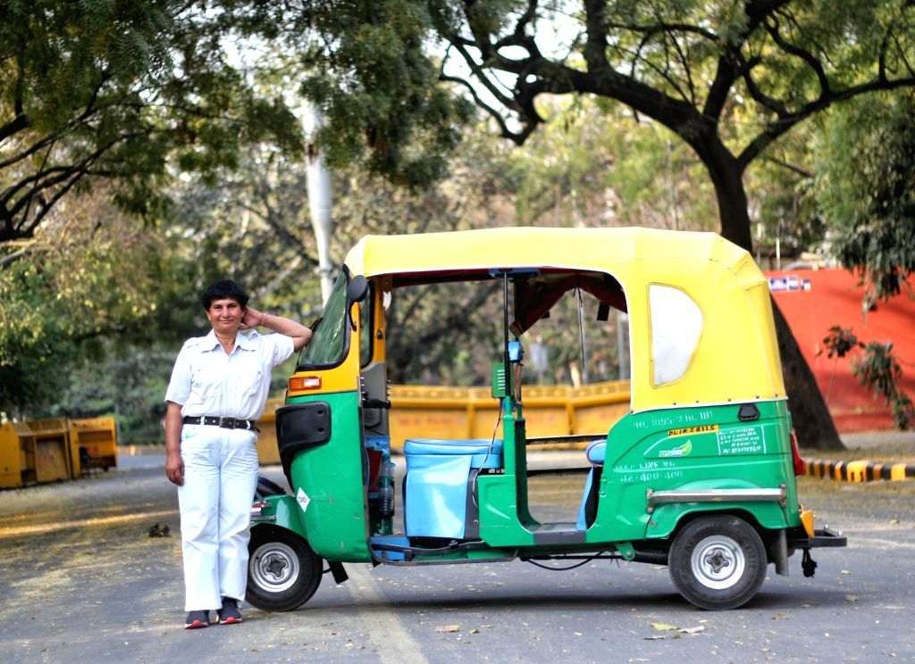 Delhi first woman auto driver Sunita Choudhary, age 40, poses with her auto and spends her free time with her auto drivers friend on the occasion of world womens day 2021. she is from Meerut UP, now ... - Sunita Choudhary