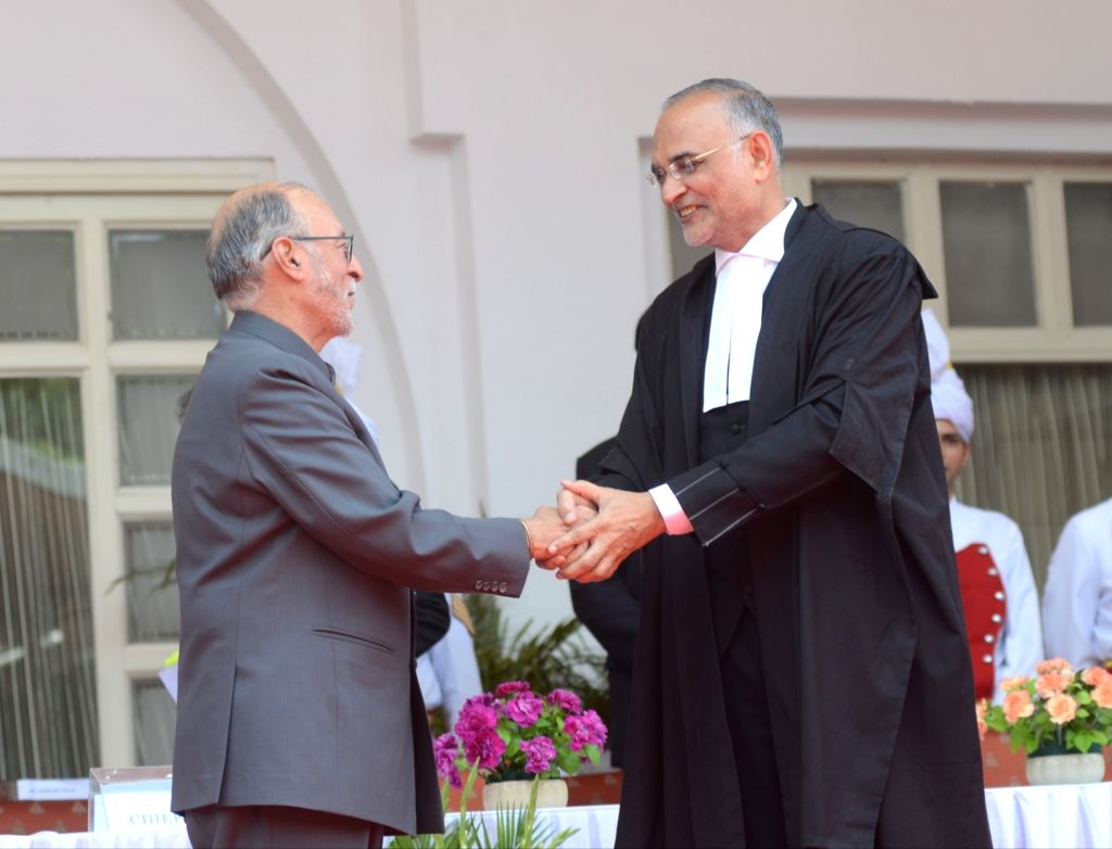 Delhi Lieutenant Governor Anil Baijal congratulates Justice Dhirubhai Naranbhai Patel after he took oath as the Chief Justice of Delhi High Court, in New Delhi on June 7, 2019. - Dhirubhai Naranbhai Patel