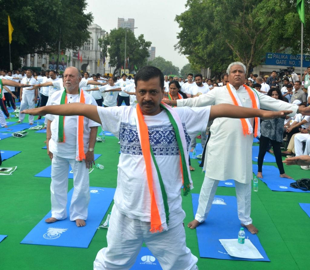 Delhi Lieutenant Governor Anil Baijal and Chief Minister Arvind Kejriwal practice Yoga Asans -postures- on International Yoga Day in New Delhi on June 21, 2017. - Arvind Kejriwal