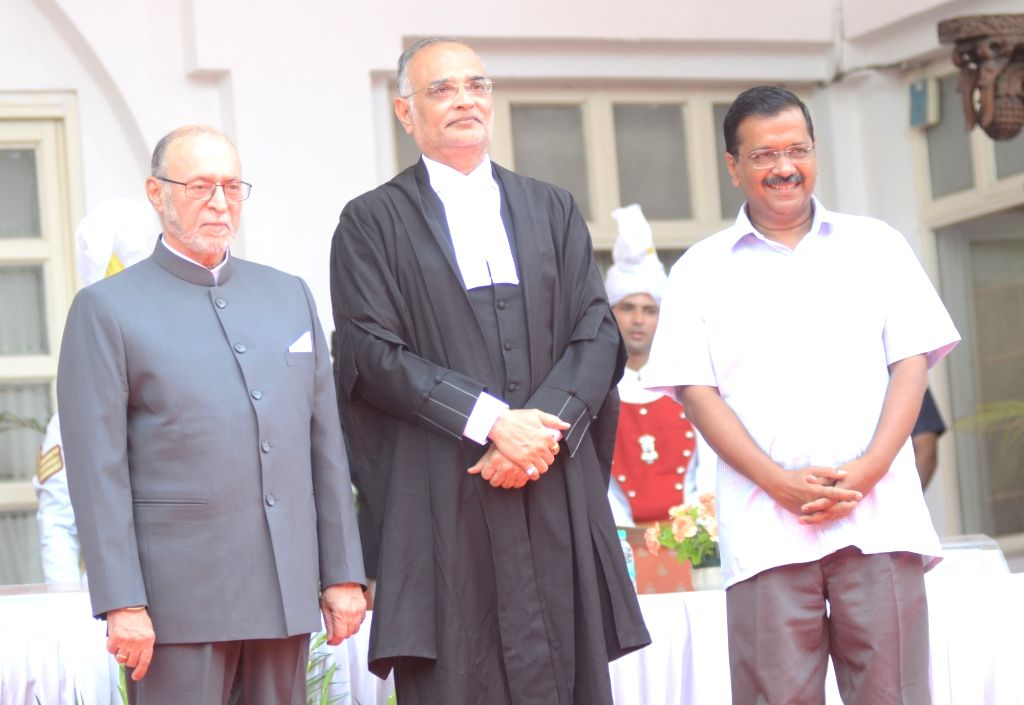 Delhi Lieutenant Governor Anil Baijal and Chief Minister Arvind Kejriwal with the newly sworn-in Chief Justice of Delhi High Court Justice Dhirubhai Naranbhai Patel, in New Delhi on June ... - Arvind Kejriwal and Dhirubhai Naranbhai Patel