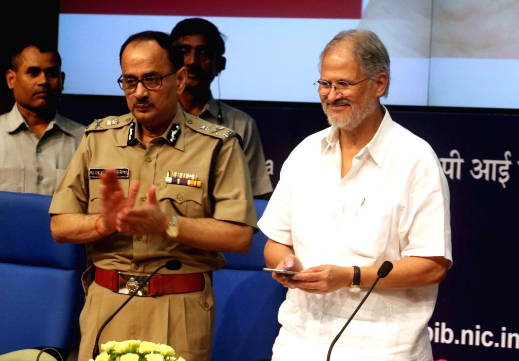 Delhi Lieutenant Governor Najeeb Jung along with Delhi Police CP Alok Kumar Verma and other officers at the launch mobile application for safety and security of senior citizens on the ... - Alok Kumar Verma
