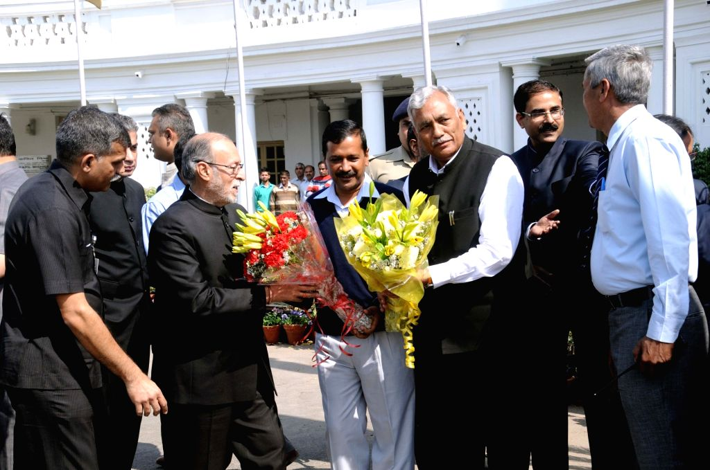 Delhi Lt Governor Anil Baijal being felicitated by Chief Minister Arvind Kejriwal and Speaker Ram Niwas Goel on the first day of Delhi Assembly's budget session in New Delhi, on March 6, ... - Arvind Kejriwal