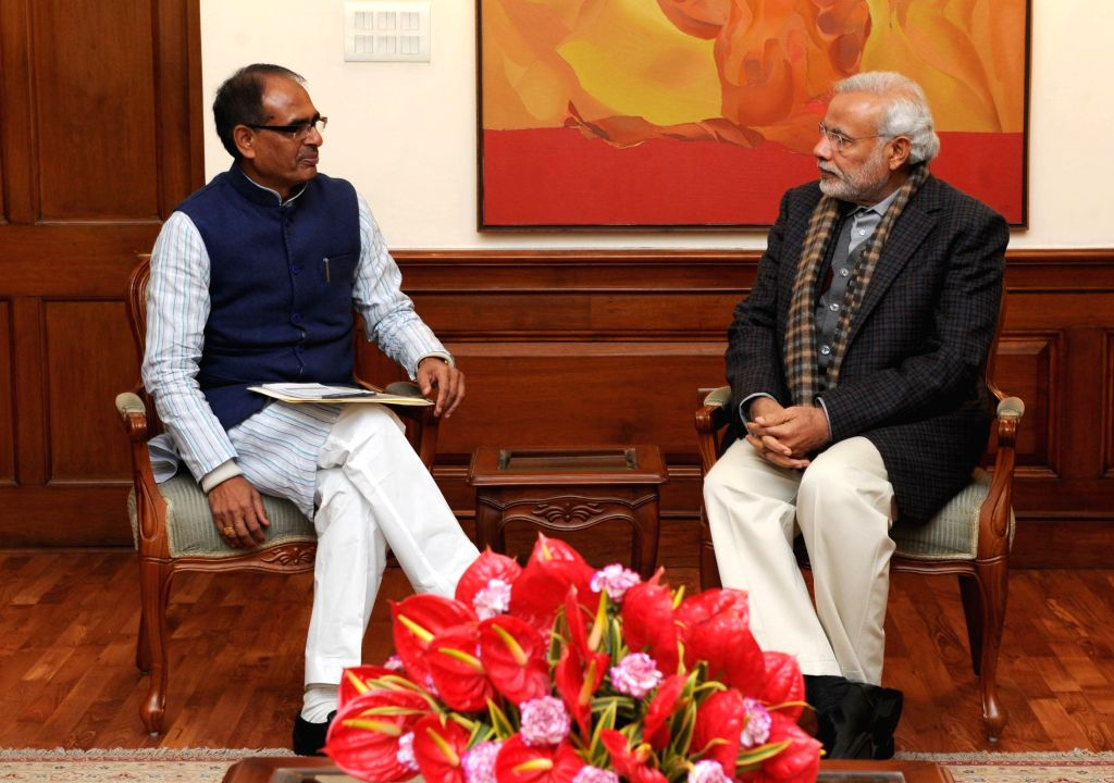 Madhya Pradesh Chief Minister Shivraj Singh Chouhan calls on the Prime Minister Narendra Modi, in New Delhi on Jan 14, 2015. - Shivraj Singh Chouhan and Narendra Modi