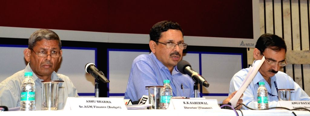 Delhi Metro Rail Corp (DMRC) Director KK Saberwal (C), spokesperson Anuj Dayal (R) and AGM/Finance Ashu Sharma (L) during a press conference regarding hike in metro fare in New Delhi on ... - Ashu Sharma