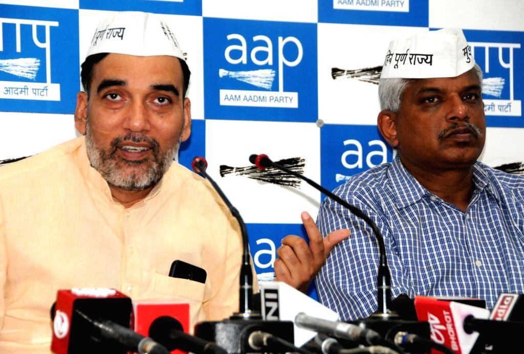 Delhi Minister and AAP leader Gopal Rai accompanied by party leader Pankaj Gupta, addresses a press conference in New Delhi, on April 11, 2019. - Gopal Rai and Pankaj Gupta