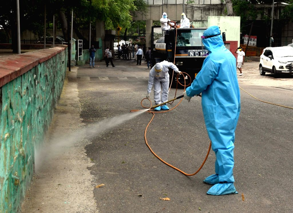 Delhi Municipal Corporation employee spraying disinfectant to sanitize the Hindu Rao hospital after a Nurse tested positive for Covid 19 during the Nationwide lockdown in New Delhi on ... - Rao