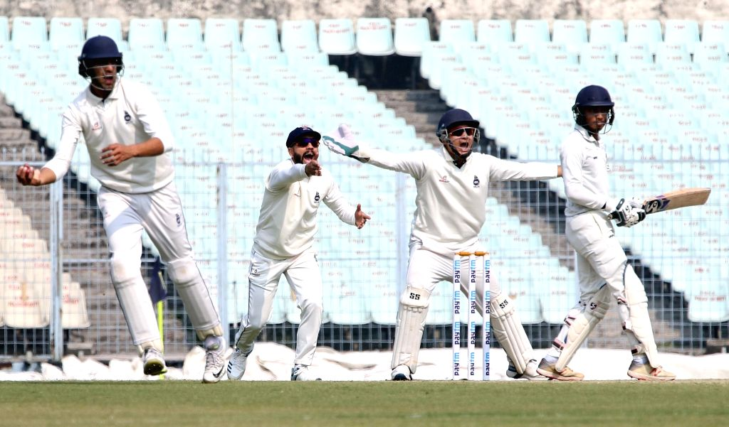 Delhi players celebrate a wicket during a Ranji Trophy match between Delhi and Bengal at the Edeen Gardens in Kolkata on Jan 27, 2020.