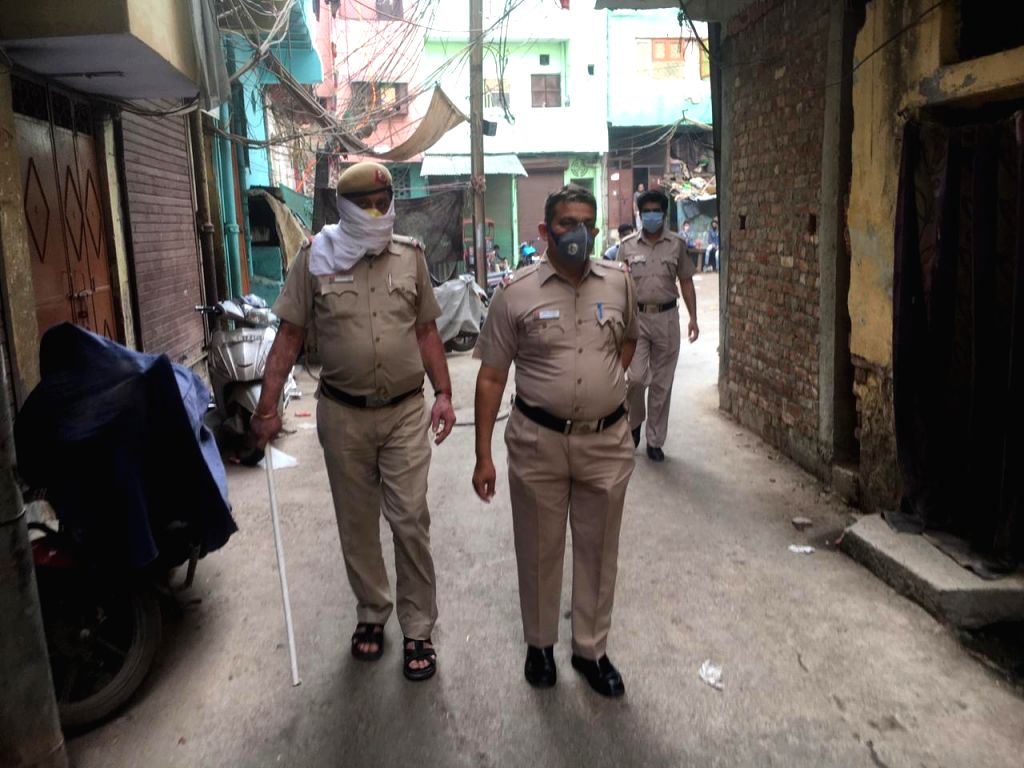 Delhi Police and CRPF conducts flag march in Nabi Karim, Chandni Mahal and Old Police Chowki during lockdown on Sunday.