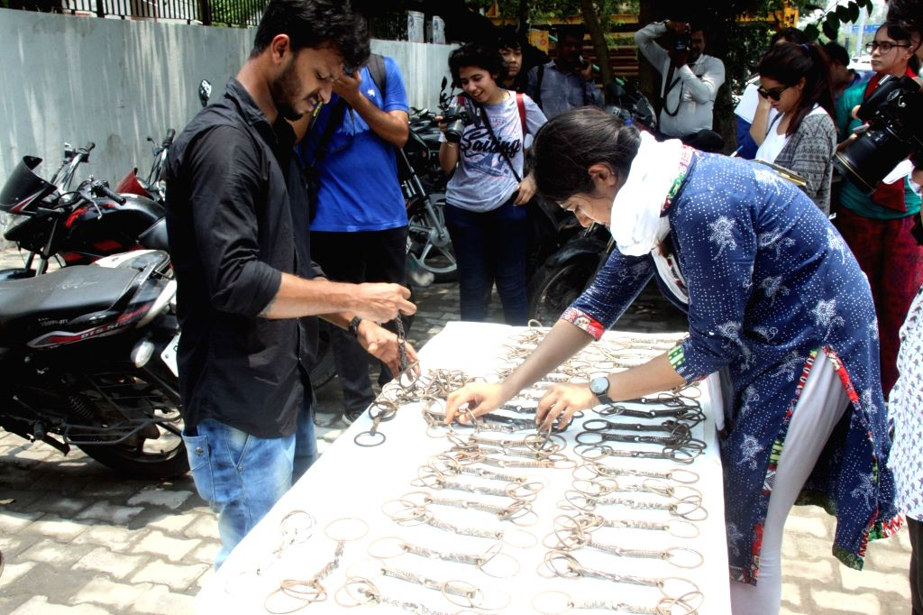 Delhi police and People for the Ethical Treatment of Animals (PETA) India members, jointly display spiked bits - illegally used to keep animals still during weddings and other such crowded ...