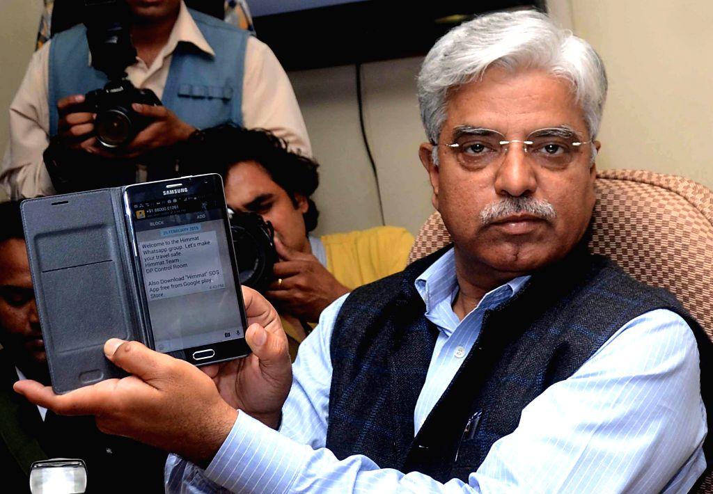 Delhi Police Commissioner B S Bassi launches  `Himmat` a WhatsApp Group at Delhi Police Headquarters in New Delhi, on Feb 25, 2015.