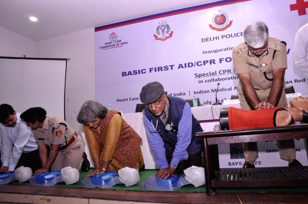 Delhi Police Commissioner BS Bassi along with Dr. K.K.Aggarwal from IMA demonstrates on life saving technique of Hands Only Cardio Pulmonary Resuscitation (CPR) during a training camp for ...