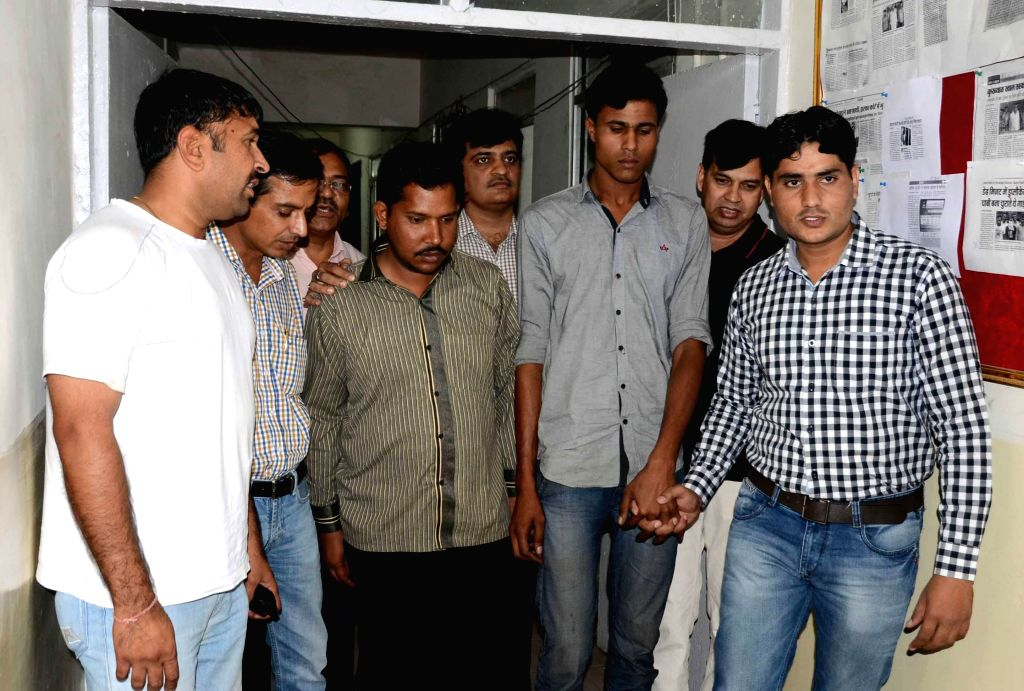 Delhi Police Crime Branch present two persons who were allegedly involved in robbing truck drivers after drugging them, before media in New Delhi on May 13, 2014.