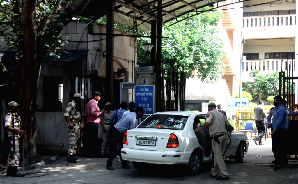 Delhi Police personnel checking a vehicle at the Rohini Court, a day after the shooting incident in Delhi on Saturday, September 25, 2021.