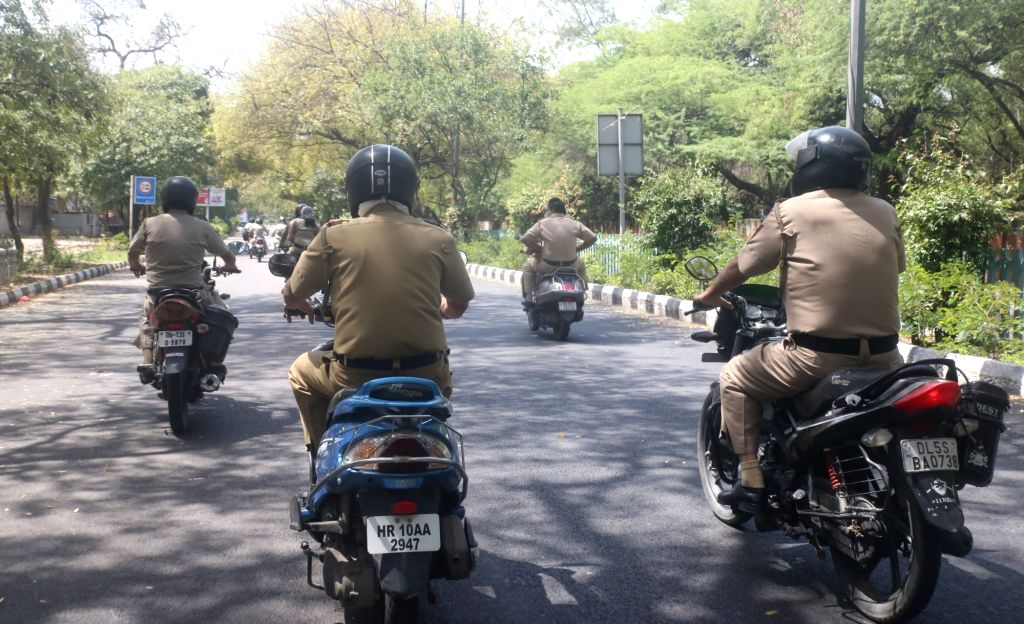 Delhi Police personnel patrol the streets keeping a vigil on violaters on Day 7 of the 21-day nationwide lockdown imposed to contain the coronavirus, on March 31, 2020.