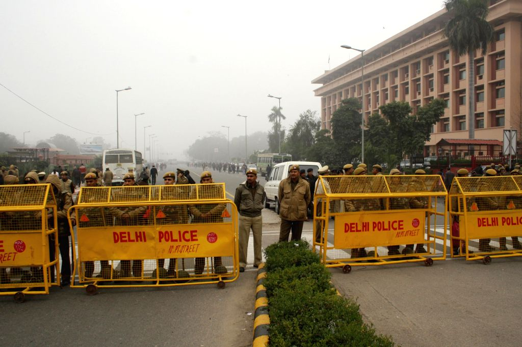 Delhi Police personnel place barricades near Rail Bhawan where Delhi Chief Minister Arvind Kejriwal and his ministers are staging a demonstration to demand action against police officials charged of alleged dereliction of duty in New Delhi on Jan.20, - Arvind Kejriwal