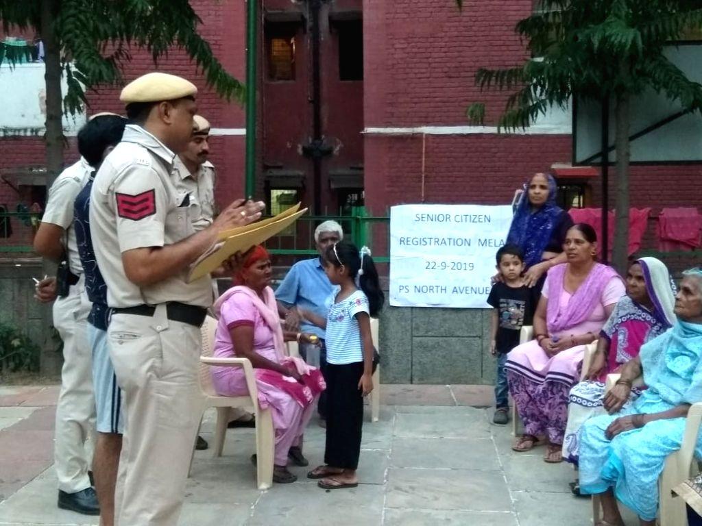 Delhi police personnel visits the residence of senior citizens for registration.